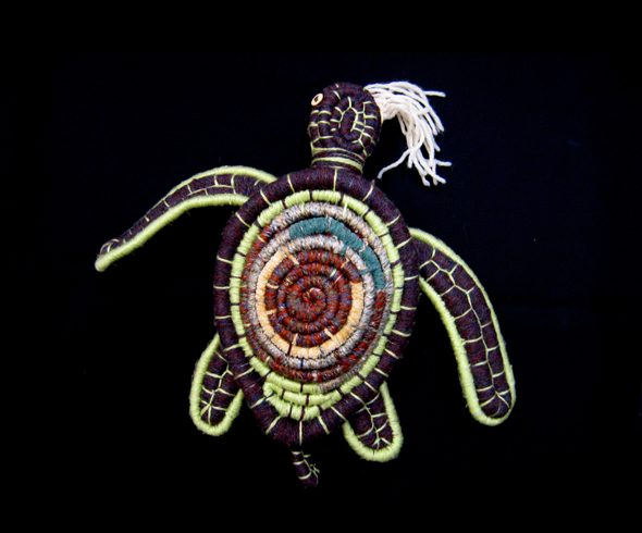 """Coiled Turtle Eating Jelly Fish"""